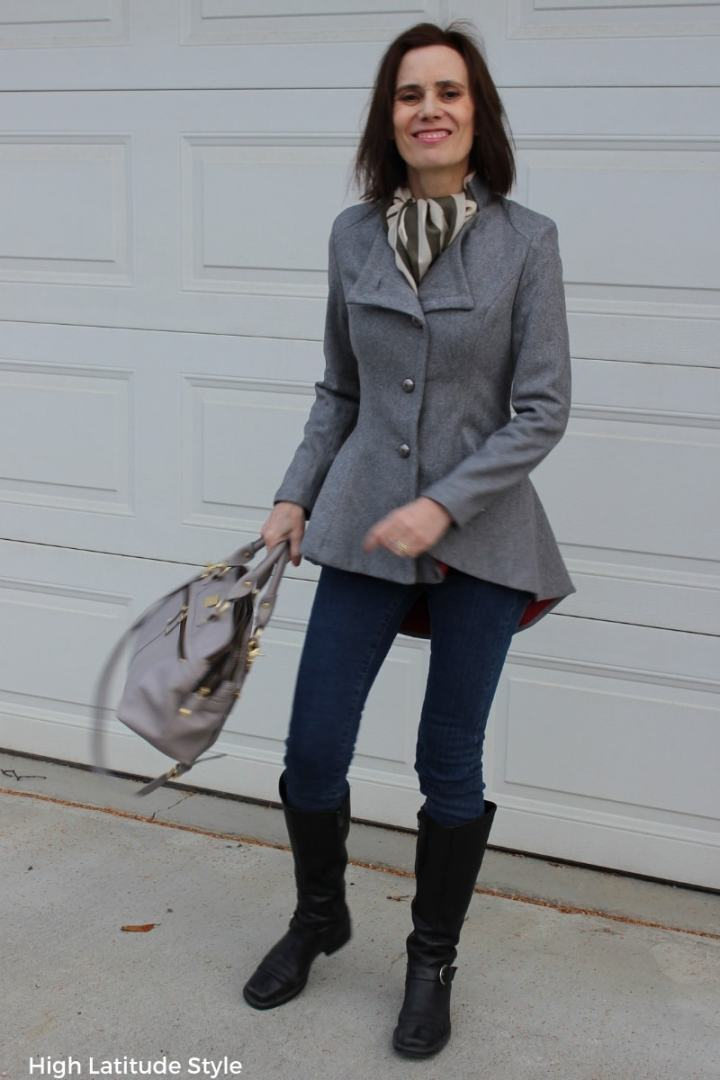riding jacket styled for fall with skinny jeans and flat boots
