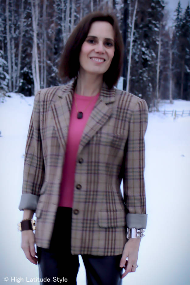 stylist in pink sweater with brown, carmel pinks baby-blue plaid blazer and pendent necklace