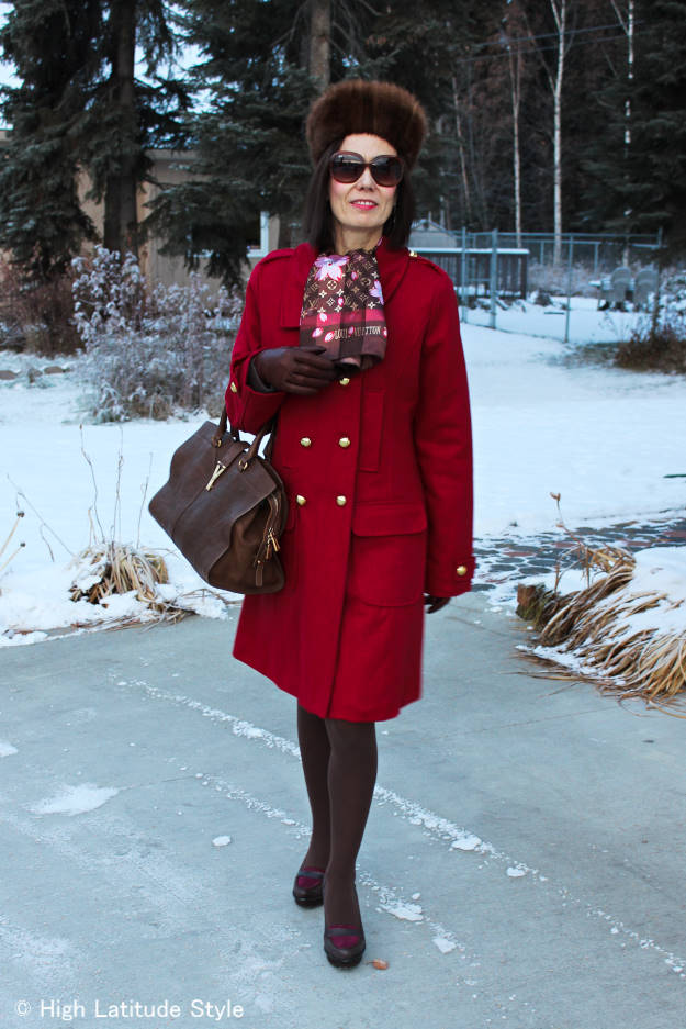 midlife blogger in winter outfit with gloves