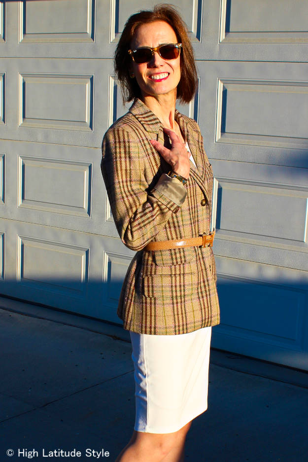 stylist in sheath dress, plaid blazer and belt work look