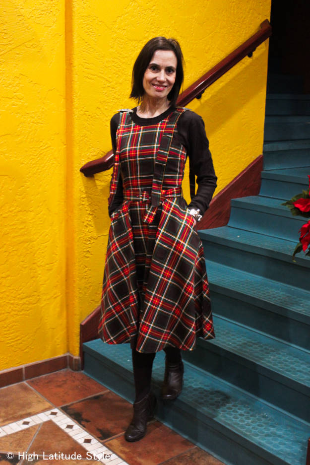 midlife style blogger looking posh in a plaid fit-and-flare holiday dress