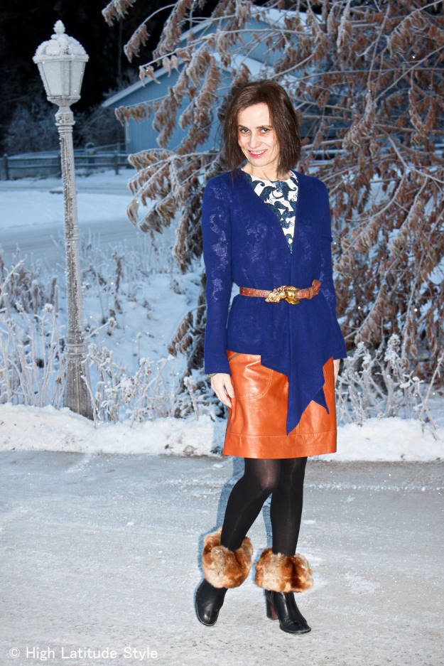 #fashionover40 Modern winter office look with paisley top, waterfall cardigan, leather skirt, booties and boot toppers