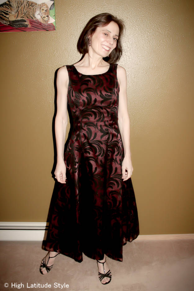over 50 years old women in red and black burned velvet tea-length gown