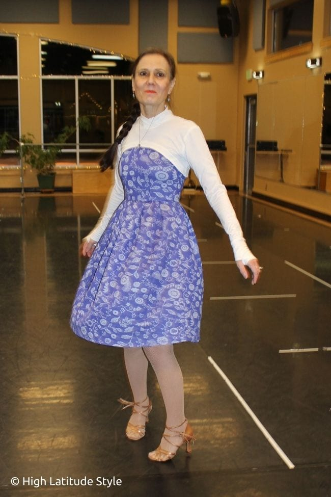 over 50 years old dancer twirling in a blue and white dress