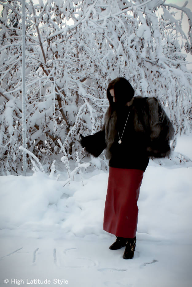 #advancedfashion mature woman in winter look with long skirt standing in the snow