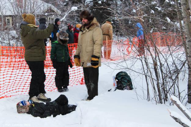 family in #Alaska #streetstyle watching the Iditarod