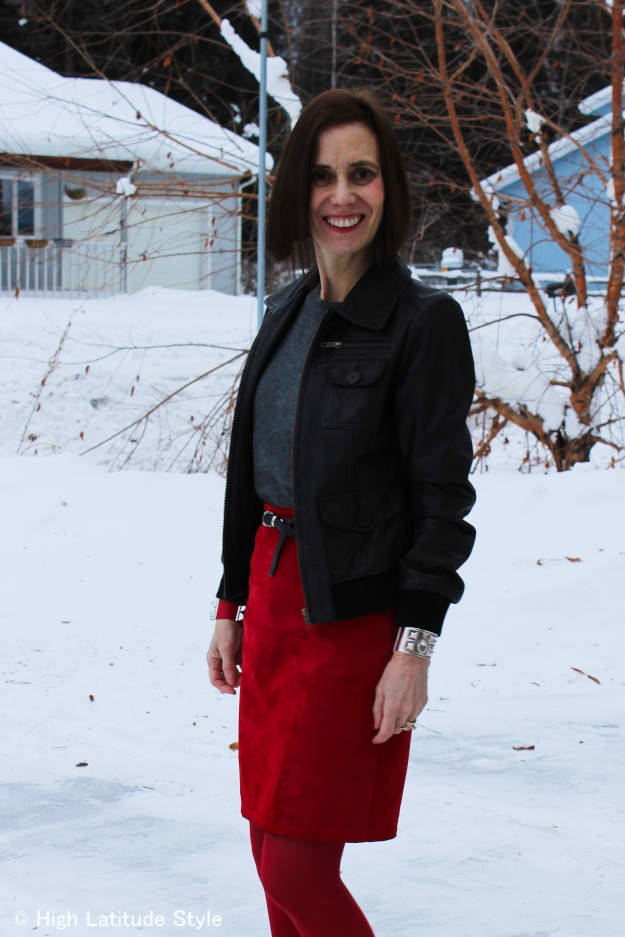 #over40fashion mature woman in casual work outfit with energizing color skirt and substituting a blazer with a leather jacket