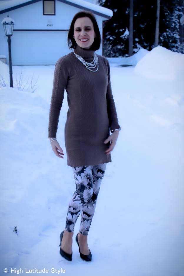 #fashionover50 woman over 50 wearing sunflower print leggings with a posh casual cable-knit dress