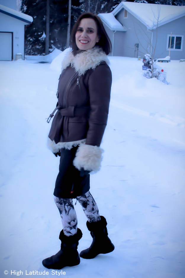 #advancefashion midlife woman in Alaska street style with leggings, thermal insulation skirt, shearling jacket and booties