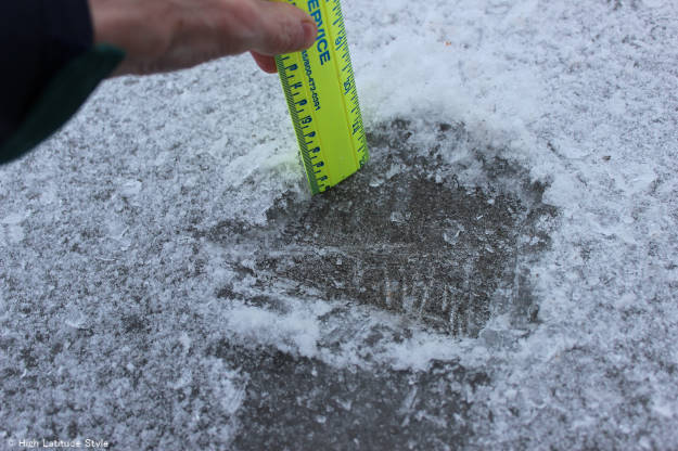 measuring the ice thickness after freezing rain in Fairbanks, Alaska