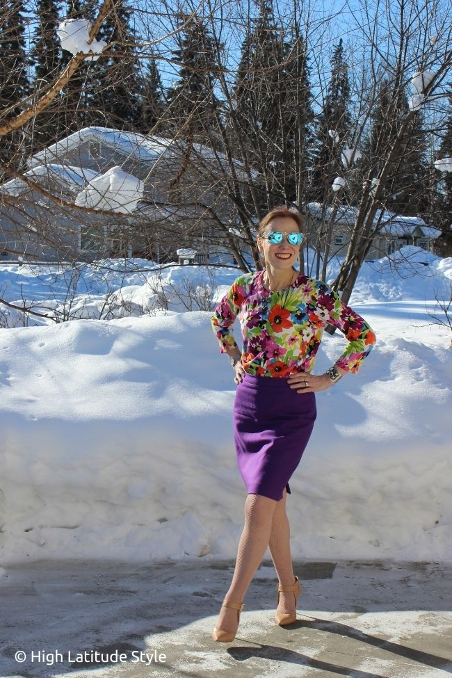 influencer in Easter outfit inspiration of flower print cardigan, solid skirt, pantyhose, pumps, sunglasses