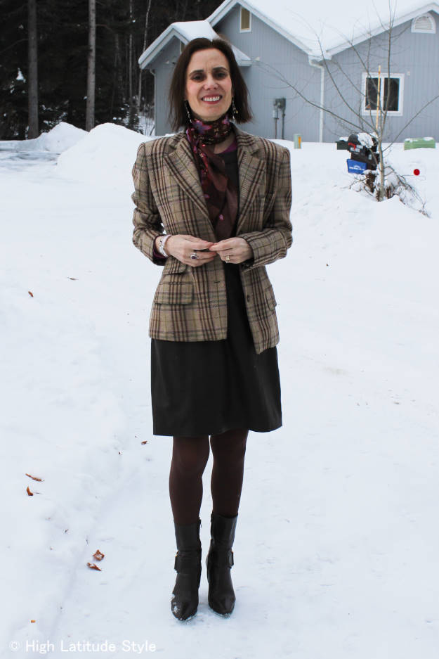mature woman dressed for Easter dinner at a resaurtant on a cold day
