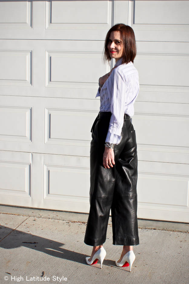 fashion blogger over 40 with long hair donning leather culottes with a shirt and pumps
