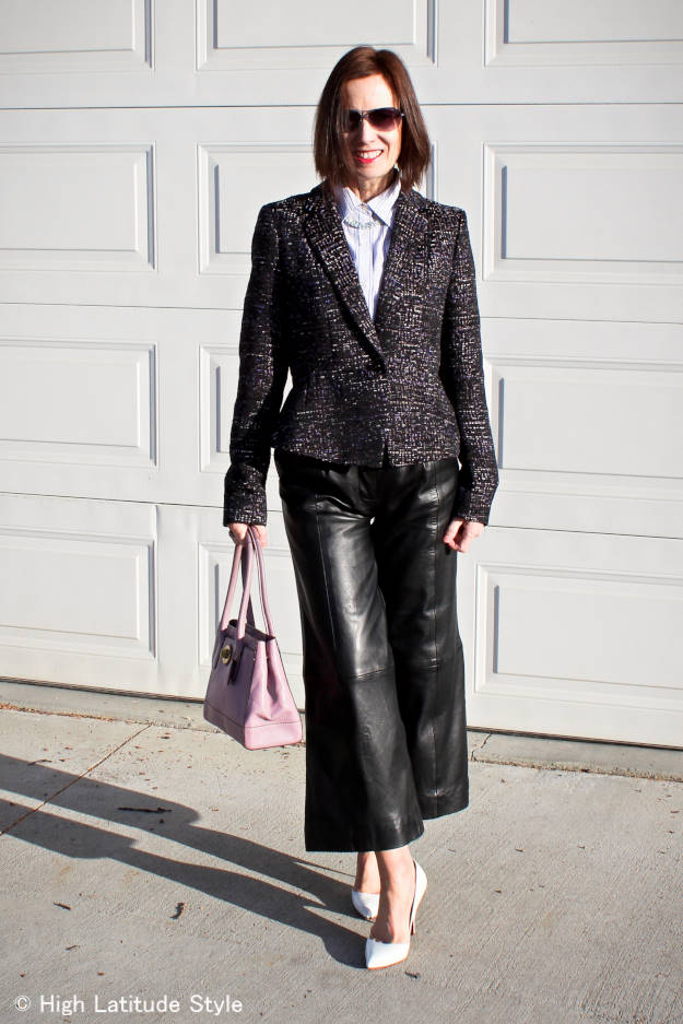 fashion blogger over 40 wearing leather culottes with a tweed jacket and shirt