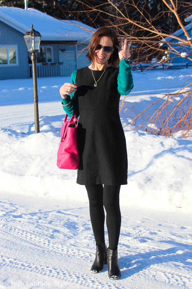 fashion blogger featuring a professional winter office outfit with sheath dress