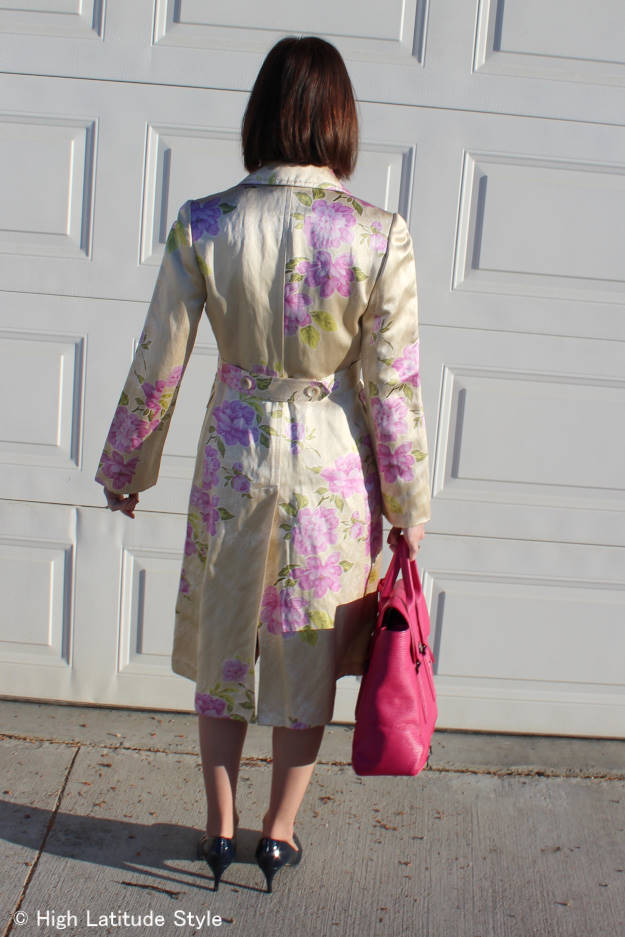 over 50 years old woman in a second hand floral print silk coat