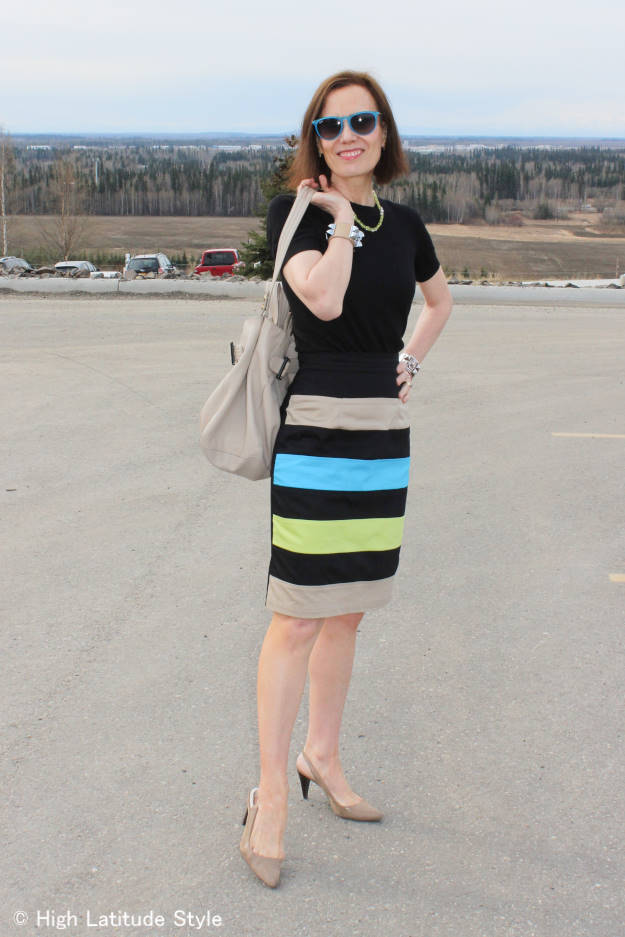 #fashionover40 woman in spring work outfit with a striped skirt and a sweater from winter