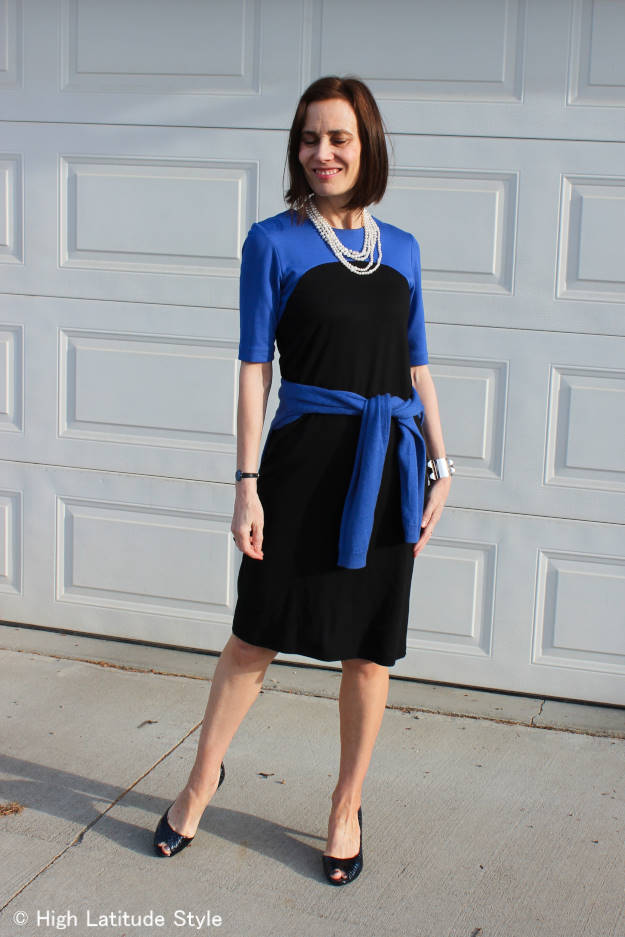midlife style blogger looking professional in color block jersey dress