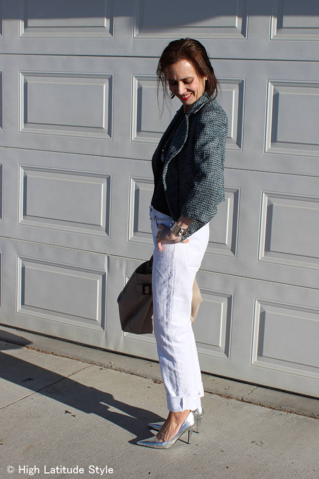 over 50 years old fashion blogger wearing metallic silver pumps with white jeans and a motorcycle jacket