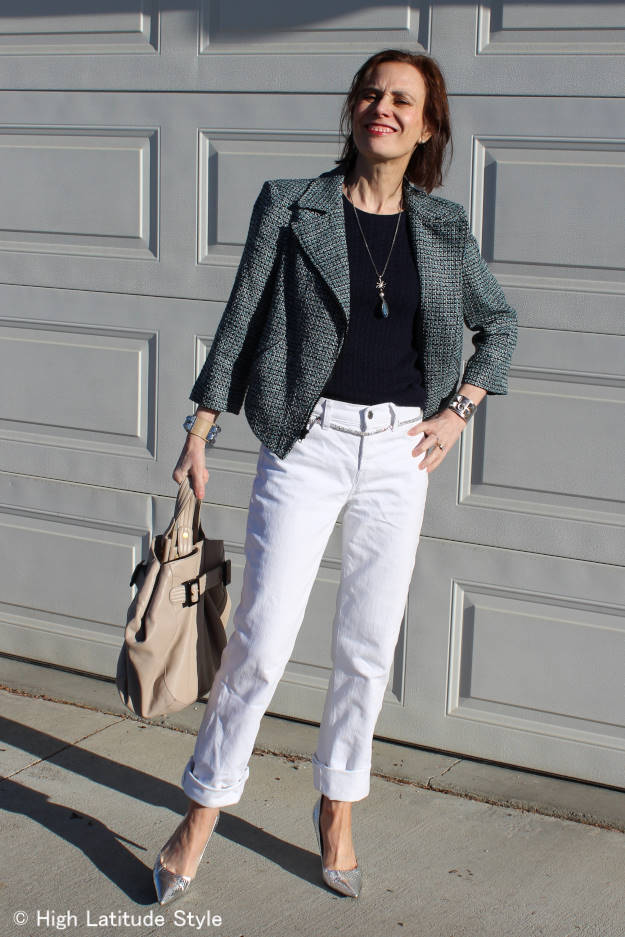style blogger in casual outfit with tweed motorcycle jacket, cable knit sweater, bag, DIY jewelry and silver pumps