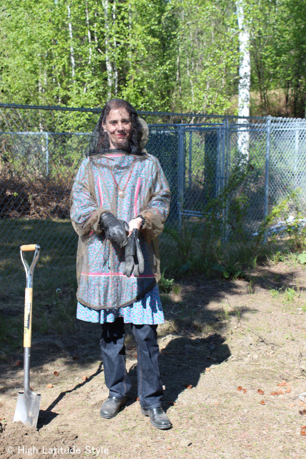 Alaskan woman gardening in a mosquito jacket