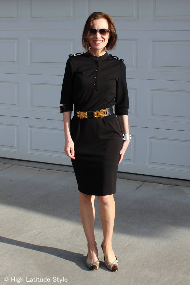 over 50 years old woman in military inspired black dress