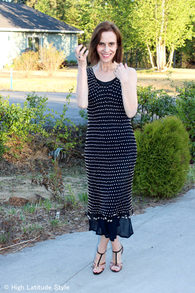 #over50fashion blogger Nicole in a mesh dress over a slip dress