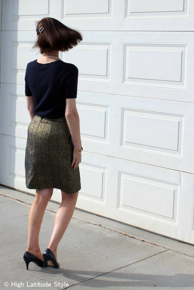 older woman in work outfit with age inappropriate about the knee skirt length