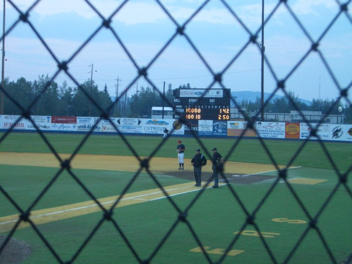 view thru net at midnight sun baseball game in Fairbanks Alaska