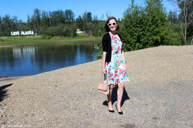 style over 50 woman in summer dress with cardigan wedges and sunglasses