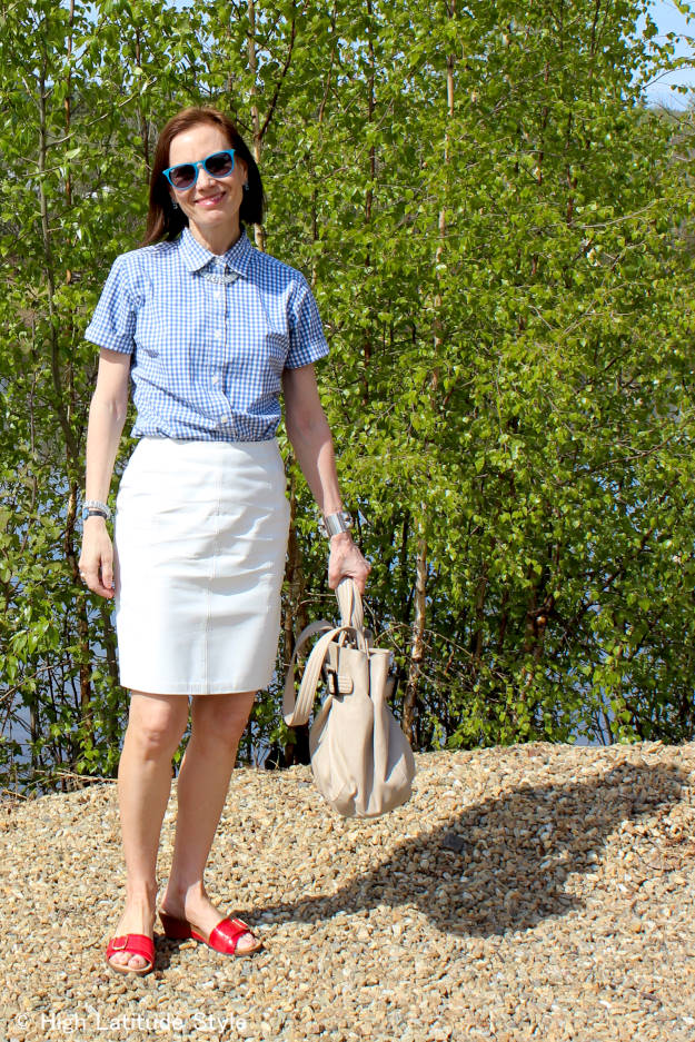 #Vionic #fashionover50 mature blogger in casual summer outfit with pencil skirt and gingham shiart wlaking on the Chena river banks