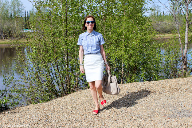 #Vionic #fashionover40 Fashion blogger in red-white-blue summer look with leather pencil skirt on a river bank in Alaska