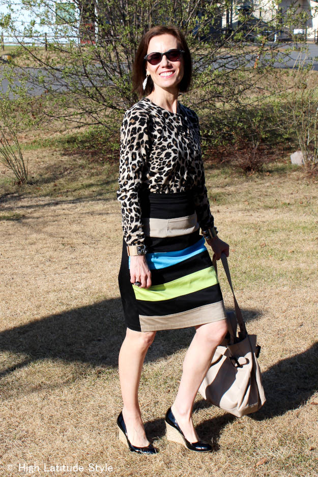 fashionover50 work outfit with leopard print top and striped skirt width=