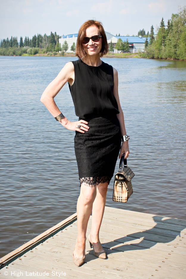over 50 years old fashion blogger in an all black work outfit with lace pencil skirt and silk shirt