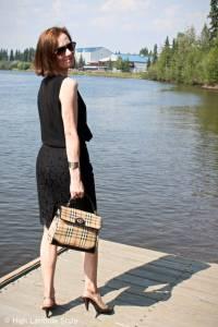 #fashionover50 Alaskan lady with pencil skirt, sleeveless top, bag and pumps