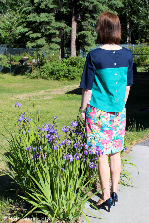 mature summer outfit with flower-patterned denim skirt and color block top