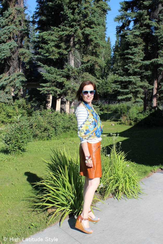 fashion blogger over 50 in posh chic outfit for Casual Friday in tan, ivory and blue