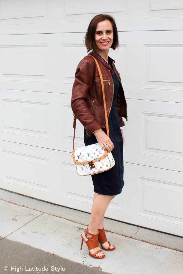 #fashionover40 midlife lady in a garment with leather jacket and sandals