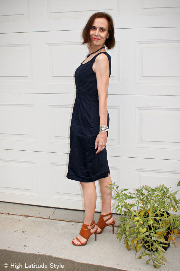 #fashionover50 woman wearing a sleek summer dress and sandals for work