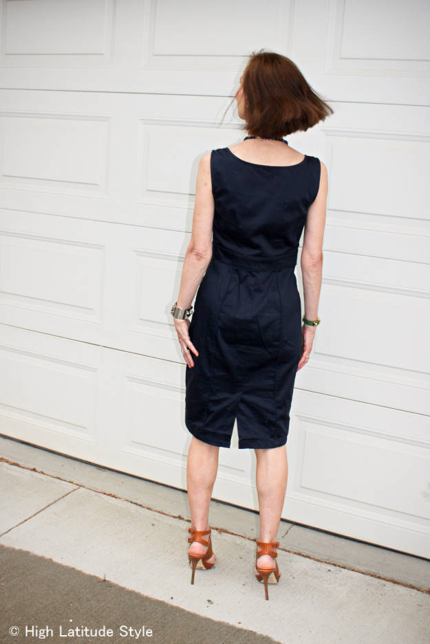 #styleover40 lady in a sleek dress with back slit and stiletto heel sandals
