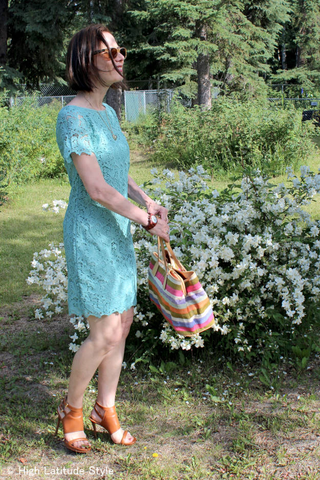 midlife fashion blogger looking ageless in a turquoise lace sheath dress