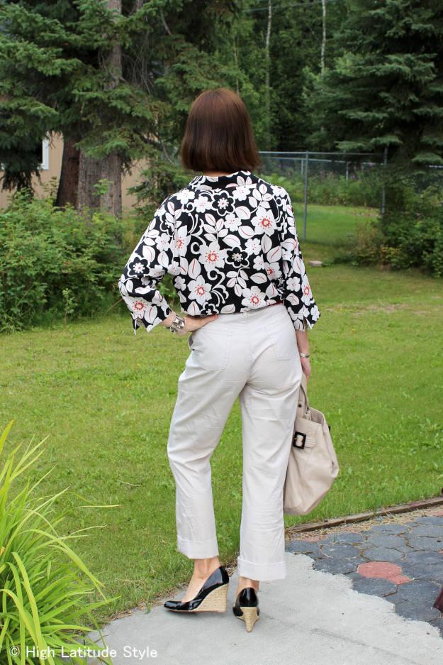 Alaskan woman in cotton trousers and silk Hawaiian print button-down shirt