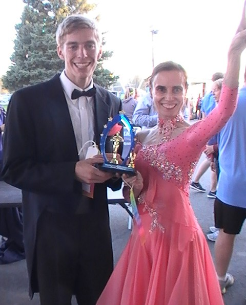 dance competion winners of third prize in their ballroom attire