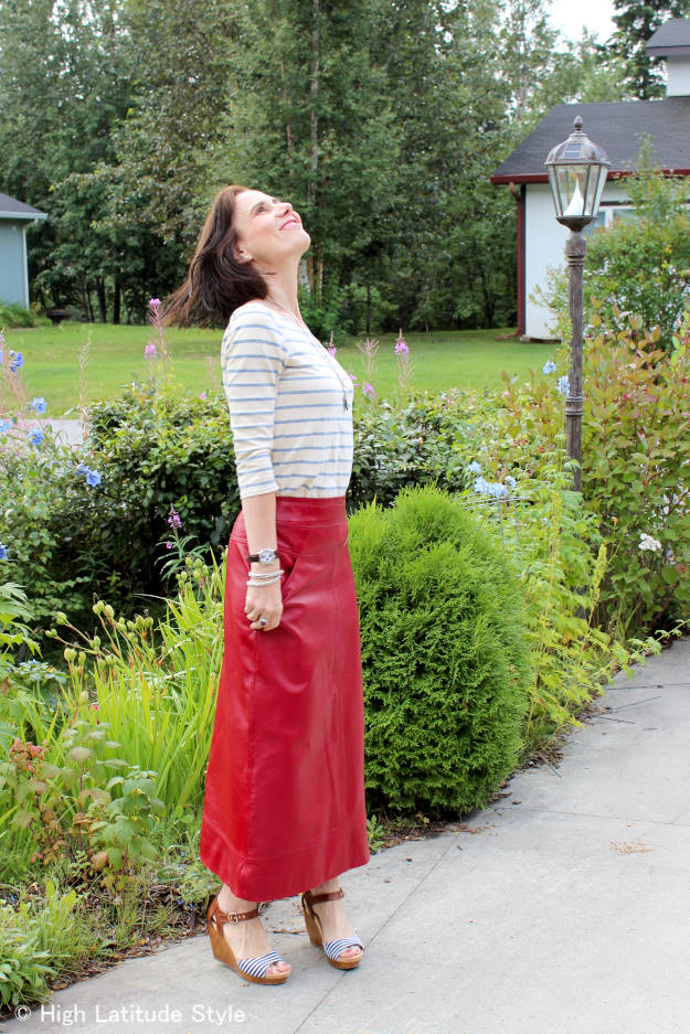 over 50 years old stylist in maxi leather skirt with 3/4 sleeve striped shirt