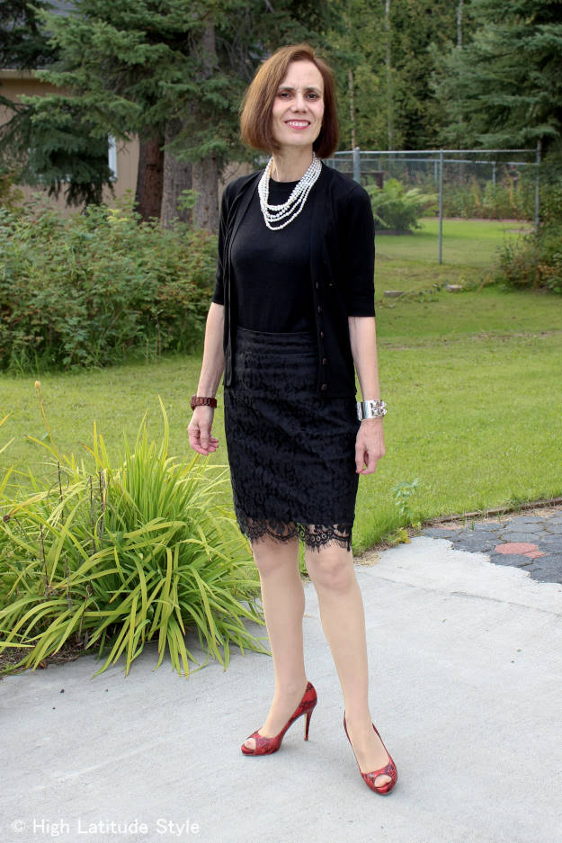midlife woman in chic lace skirt and knit top