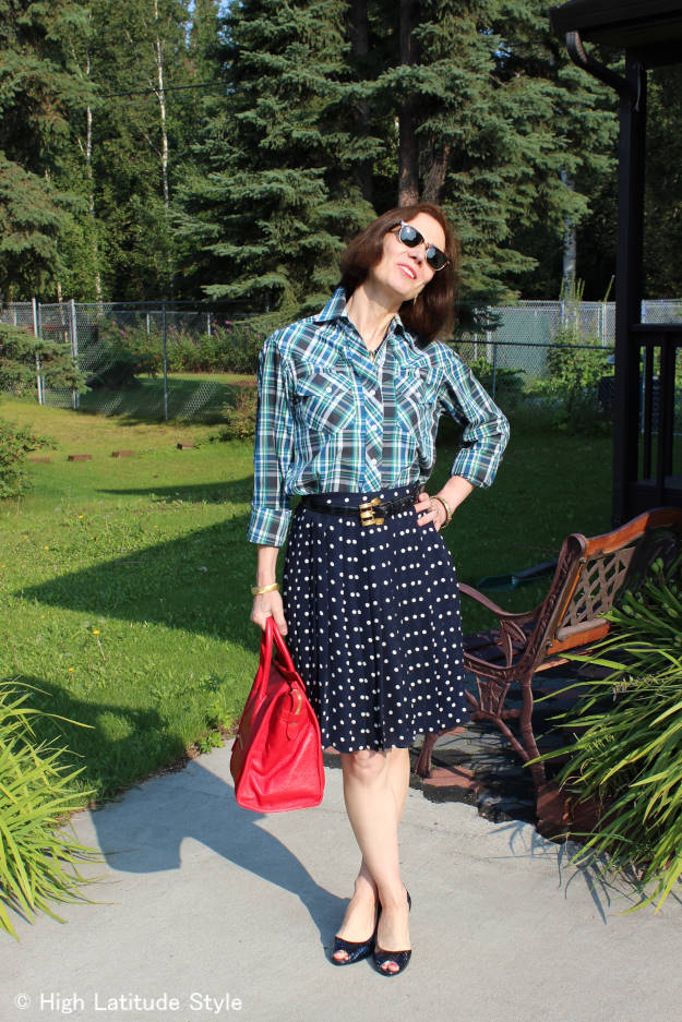 over 50 years old fashion blogger in plaid shirt and polka dot skirt