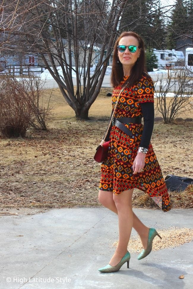 style book author in Native American inspired print dress