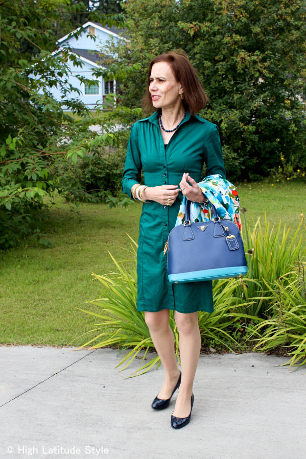 #fashionover40 #fashionover50 woman in a teal shirt dress at the Top of the World Style linkup party