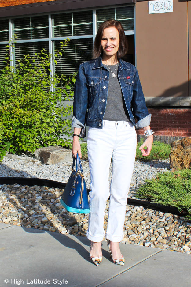 mature woman in white denim boyfriend jeans with denim jacket
