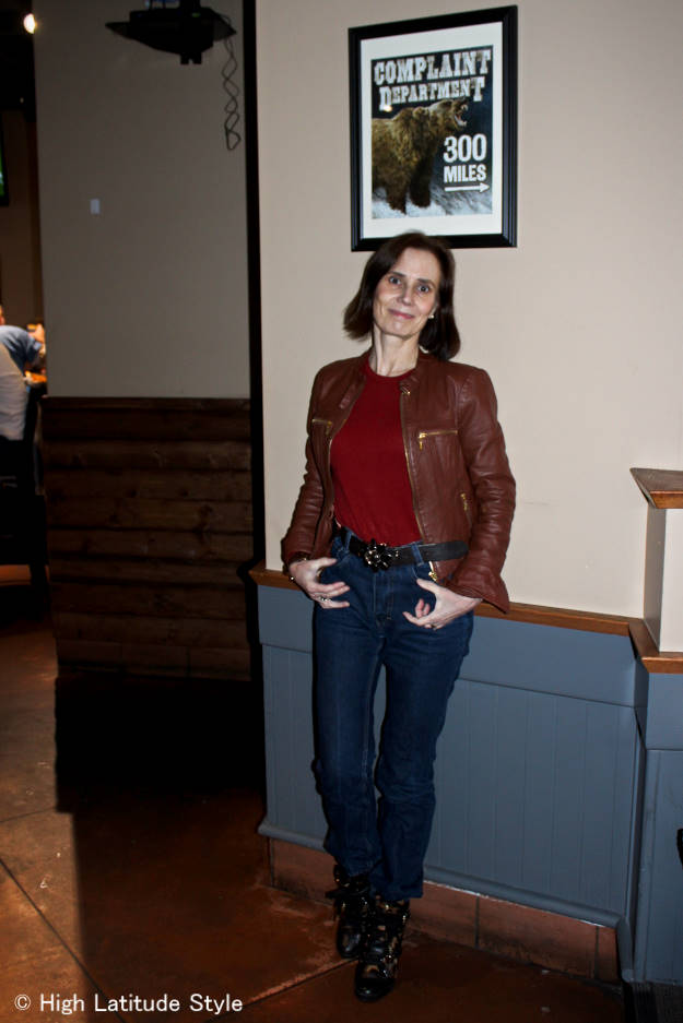 #fashionover50 midlife woman in leather jacket, jeans and sweater